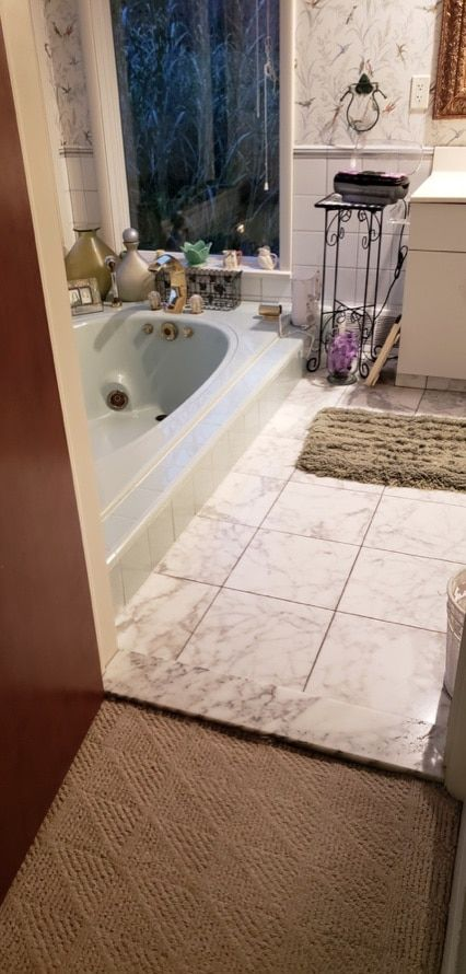 A high style master bathroom transformation and walk in closet